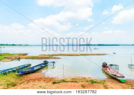 Small fishing boat moored on lake in Thailand