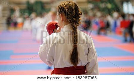 Sports kids - teenager girl sportsmen on karate use a protective mouthguard, close up