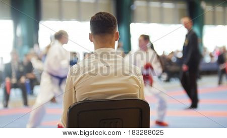 Martial art competitions- karate - cache looks at female teenager's karate fighting, close up