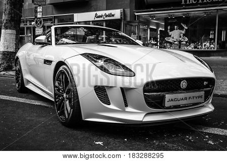 BERLIN - JUNE 14 2015: Sports car Jaguar F-Type V8S Convertible (since 2013). Black and white. The Classic Days on Kurfuerstendamm.