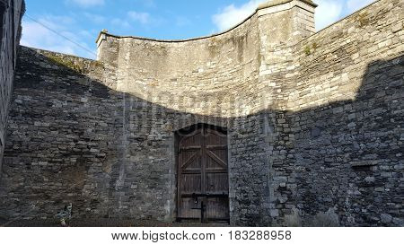 Entrance gate and stone walls in an ancient irish jail