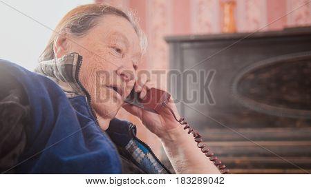 Old Woman pensioner speak landline phone, portrait, close up