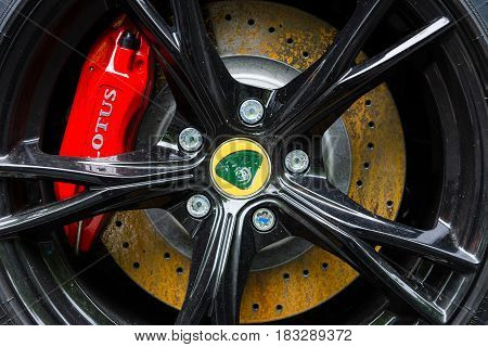 BERLIN - JUNE 14 2015: The front brake disc of the sports car Lotus Exige S Coupe. The Classic Days on Kurfuerstendamm.