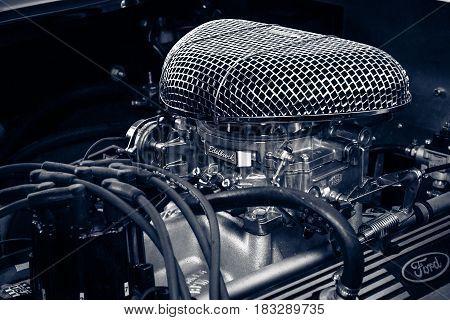 BERLIN - JUNE 14 2015: Engine of a roadster Shelby AC Cobra 427 1966. Toning. Stylization. The Classic Days on Kurfuerstendamm.