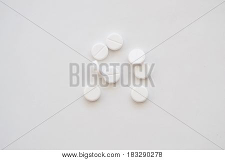 Photo of few pills on white background