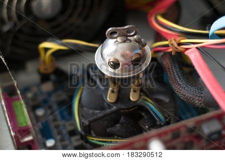 Beautiful photo of little robot repairing computer