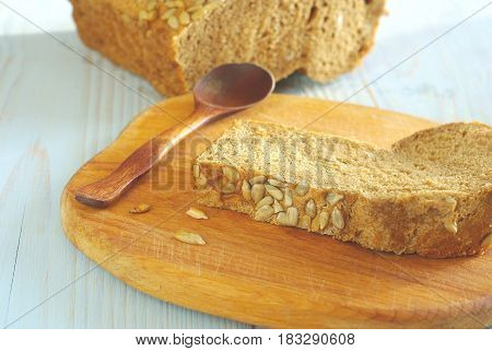 Bread slice organic natural food homemade wholegrain healthy nutrition. Tasty dieting baker meal closeup. Rustical bread on wooden desk oldstyle eating. Selective focus crust piece.