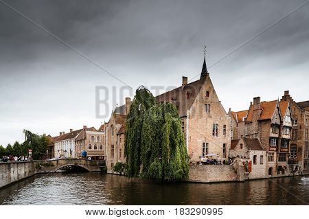 Bruges Belgium - July 29 2016: Canal scene in the city of Bruges. The historic city centre is a World Heritage Site of UNESCO. It is known for his picturesque cobbled lanes and dreamy canals