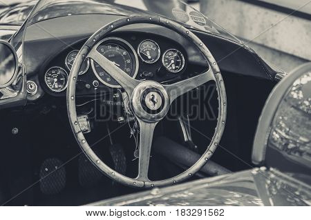 BERLIN - JUNE 14 2015: Cockpit of a sports car Ferrari 500 TR 1956. Black and white. Stylization. The Classic Days on Kurfuerstendamm.