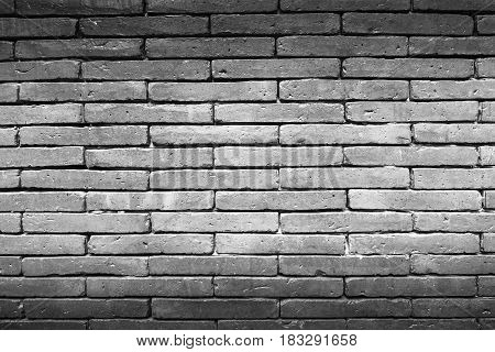 Brick wall texture, brick wall background for interior or exterior design. Dark edged.
