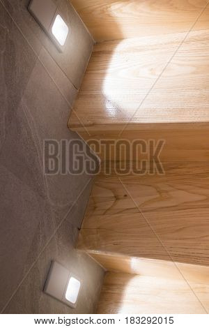 Wooden Stairs Step With Wall Light stock photo