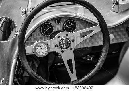 BERLIN - JUNE 14 2015: Cockpit of a custom race car based Alfa Romeo and engine of BMW 328 1951. Designer Karl Baum pilot Willibald Heller. The Classic Days on Kurfuerstendamm.