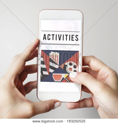 Hands holding mobile phone of movies theatre media entertainment