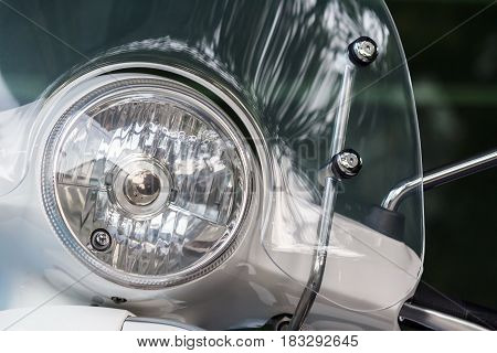Motorcycle headlight or Scooter headlight with windshields.