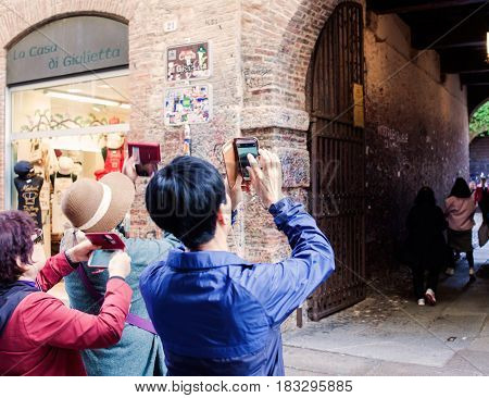 VERONA ITALY - APRIL 07: Chinese tourists take photos in Verona on April 07 2017