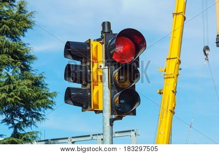 Red traffic light in the city street .