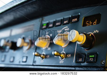 Autopilot instrument panel and controls. Flight Control Unit (FCU) with knobs dials and buttons.