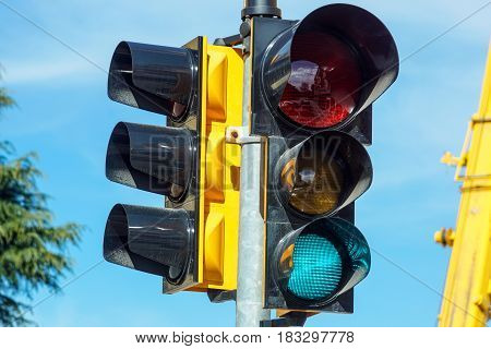 Traffic lights with the green light lit .