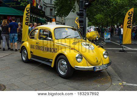 BERLIN - JUNE 14 2015: A compact car VW Beetle in the color ADAC (Allgemeiner Deutscher Automobil-Club eV). The Classic Days on Kurfuerstendamm.