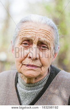 Portrait of a lonely senior lady posing outdoor