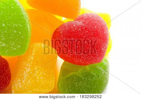 Tasty jelly candies on white background, closeup