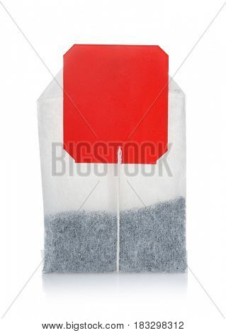 Teabag with red blank label isolated on white
