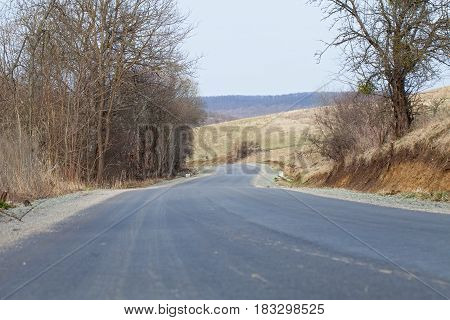 Picture of a rural driveway in March in Transylvania Romania