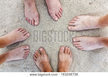 feet of family at the beautiful sandy beach