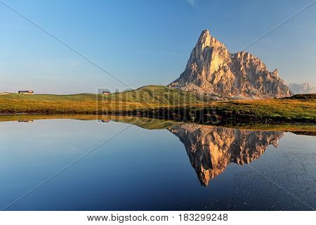 Passo Giau and Cima ra Gusela in lake reflection Dolomites - Italy