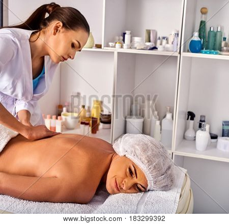 Massage room for therapy deals. Woman therapist making manual therapy back. Hands of masseuse treatment of spinal injuries 40 old mature client in spa salon.