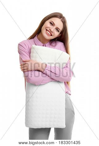 Young smiling woman hugging orthopedic pillow on light background. Healthy posture concept