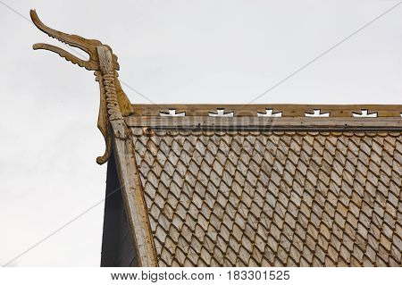 Lom medieval stave church roof detail. Viking symbol. Norway tourism highlight