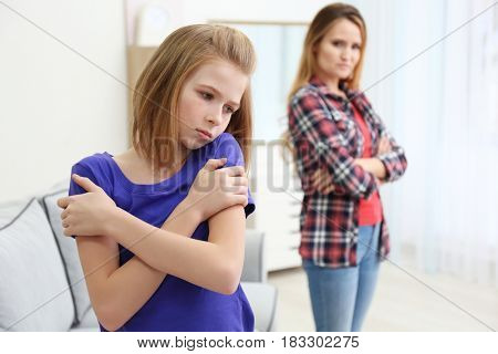 Quarrelled mother and daughter at home