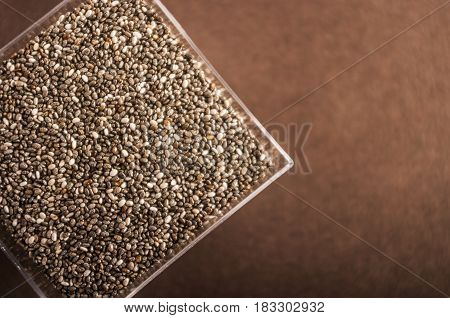 Healthy Chia seeds close up on dark background