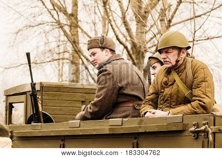 Gomel, Belarus - November 26, 2016: Soldiers of the Red Army are sitting in the back of a military truck. Reconstruction - liberation of the city of Gomel