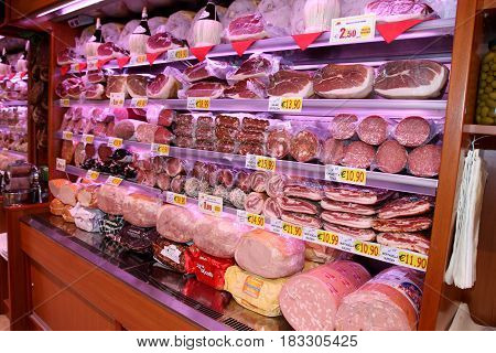 ROME, ITALY. March 26, 2014: Shelves with typical sliced Italian meat (prosciutto) inside a new market (M.A. Supermarket) opening in Rome, Italy.