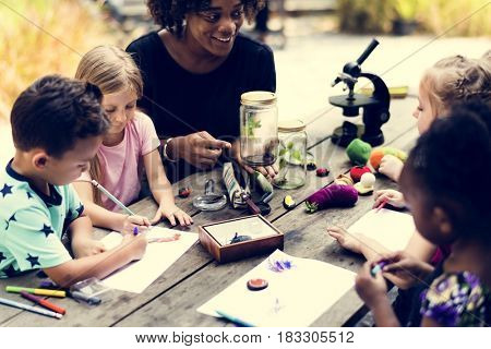 Group of kids classmates learning biology drawing class