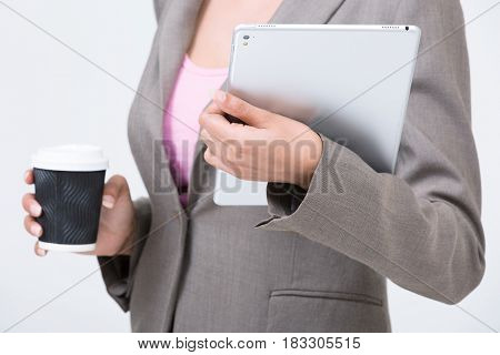 Business woman hold tablet and coffee cup