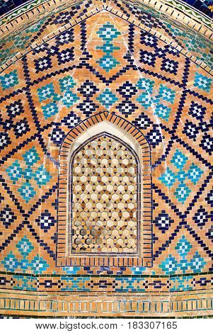Black blue and yellow patterns on the interior wall of the ancient oriental building