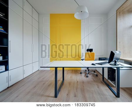 Room in a modern office with white-yellow walls and a parquet on the floor. There is a white table with computer, lockers, orange armchair, shelves, hanging lamp with a shade, wooden window. Horizontal.