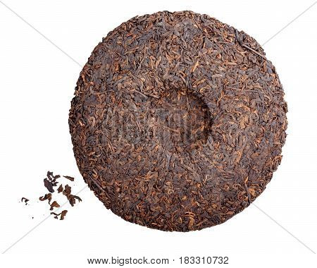 Round flat disc of puer tea isolated on white background. Pressed Chinese fermented Pu-erh tea.
