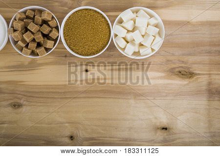Different Kind Of White And Brown Sugar On Old Brown Table