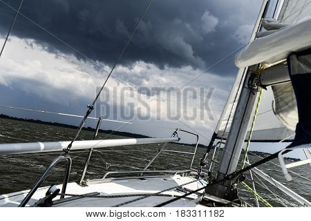 Sailboat in open sea on a storm