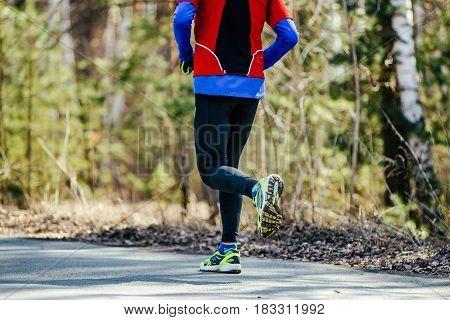 real athletic runner man running asphalt road in city park
