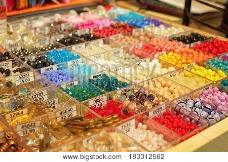 Assortment of beads in boxes at shop