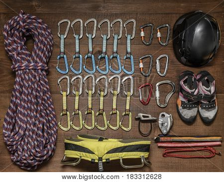 Climbing equipment lying on a wooden floor.