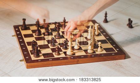 hands playing chess with motion ghost effect