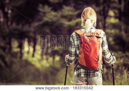 Blond woman hiking with backpack