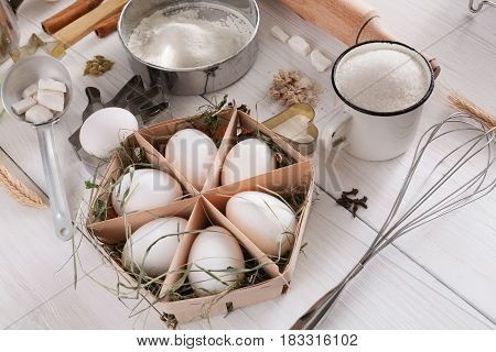 Baking background. Cooking ingredients for dough and pastry making on white rustic wood. Culinary classes concept