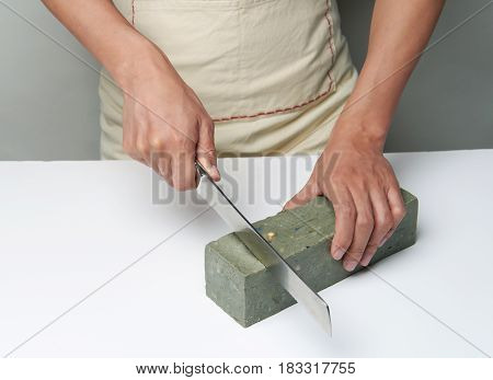 Man Cutting A Handmade Soap With A Knife